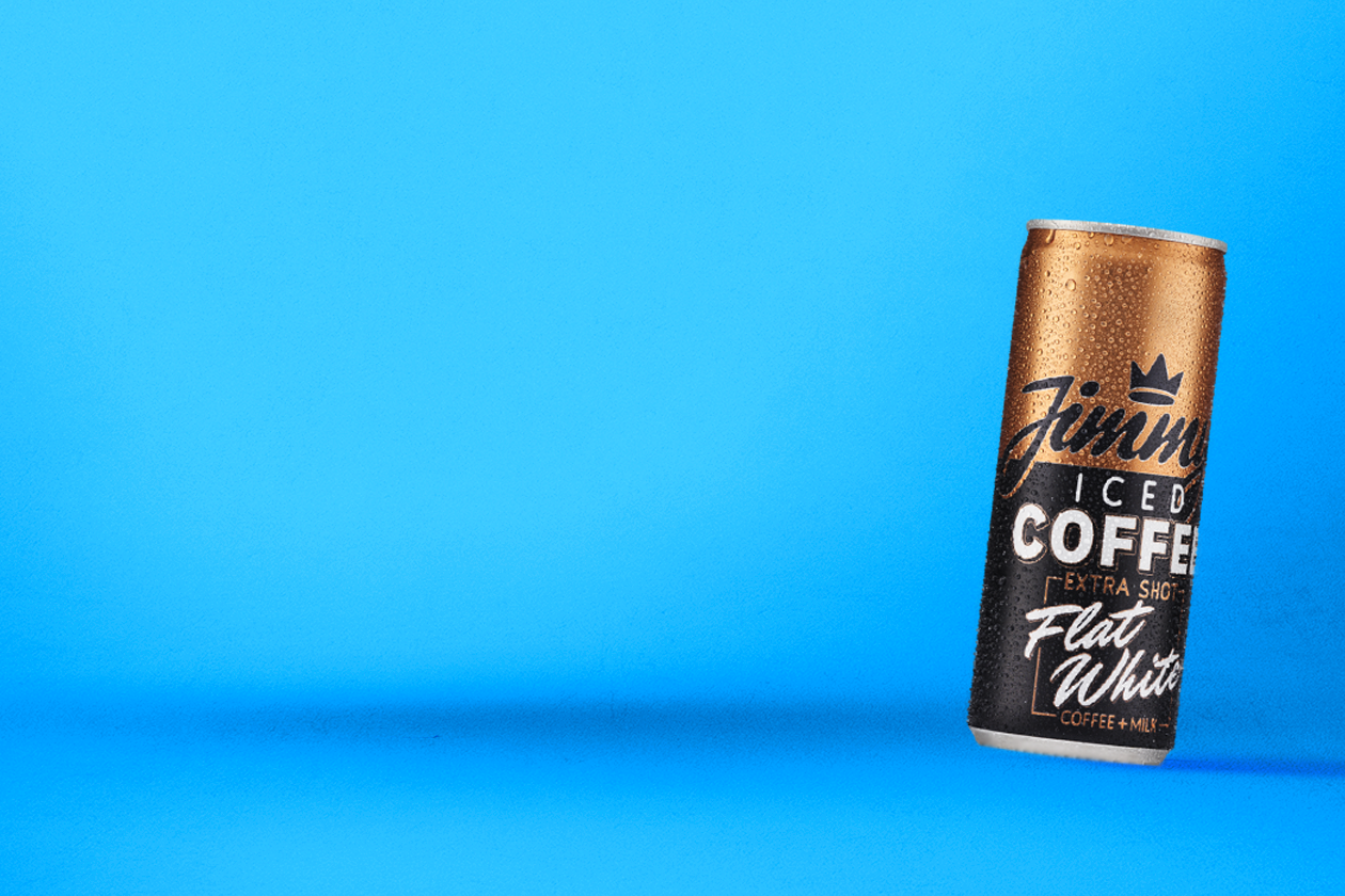 Jimmy's Iced Coffee can on blue background